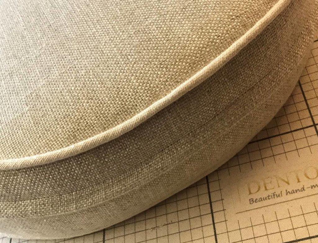 Sofa cushion against gridden measuring table