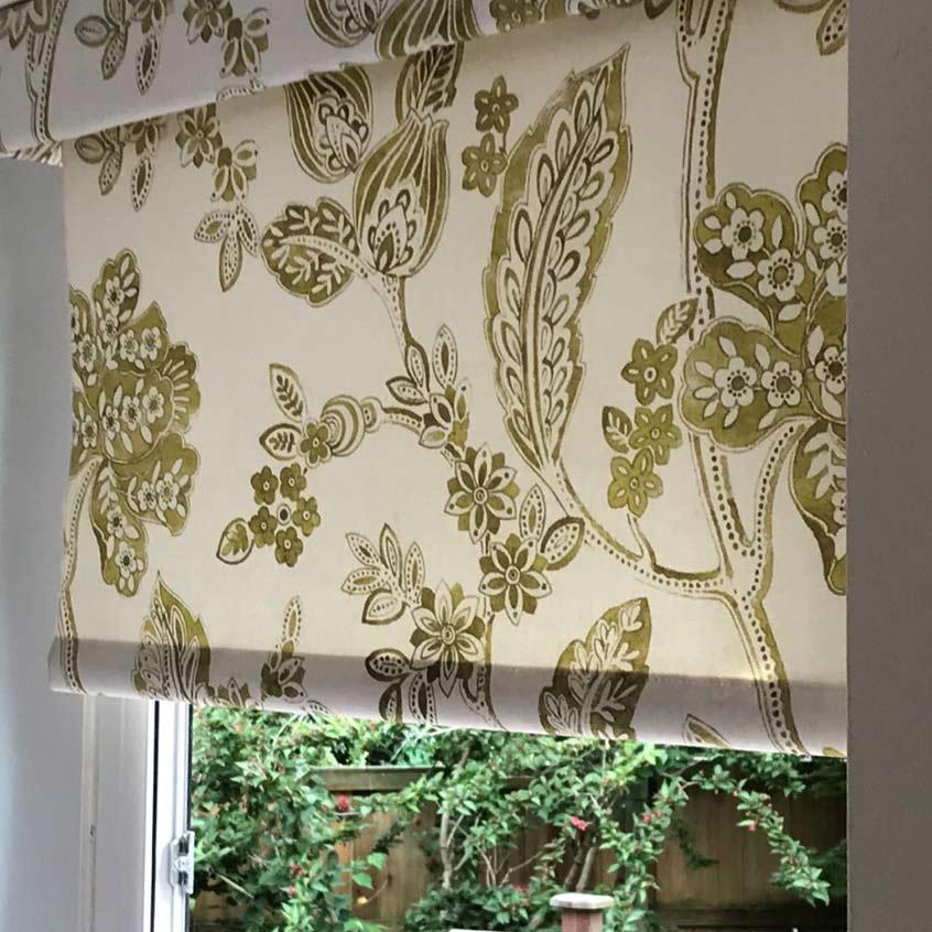 floral patterned roller blind against window